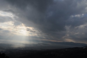 The sun shining on an Umbrian valley.