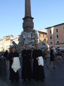 Two confreres and I in cassock in Piazza Navona