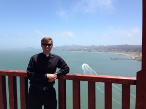 A picture from the Golden Gate Bridge with San Francisco in the background.