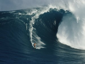 a-surfer-rides-a-powerful-wave-off-the-north-shore-of-maui-island-1
