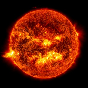 The bright light of a solar flare on the left side of the sun is seen in this NASA handout image